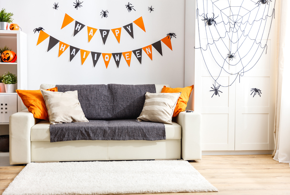 Cut triangles to make Halloween pennants. Colour them orange and black. Don't forget the 'Happy Halloween' wishes!