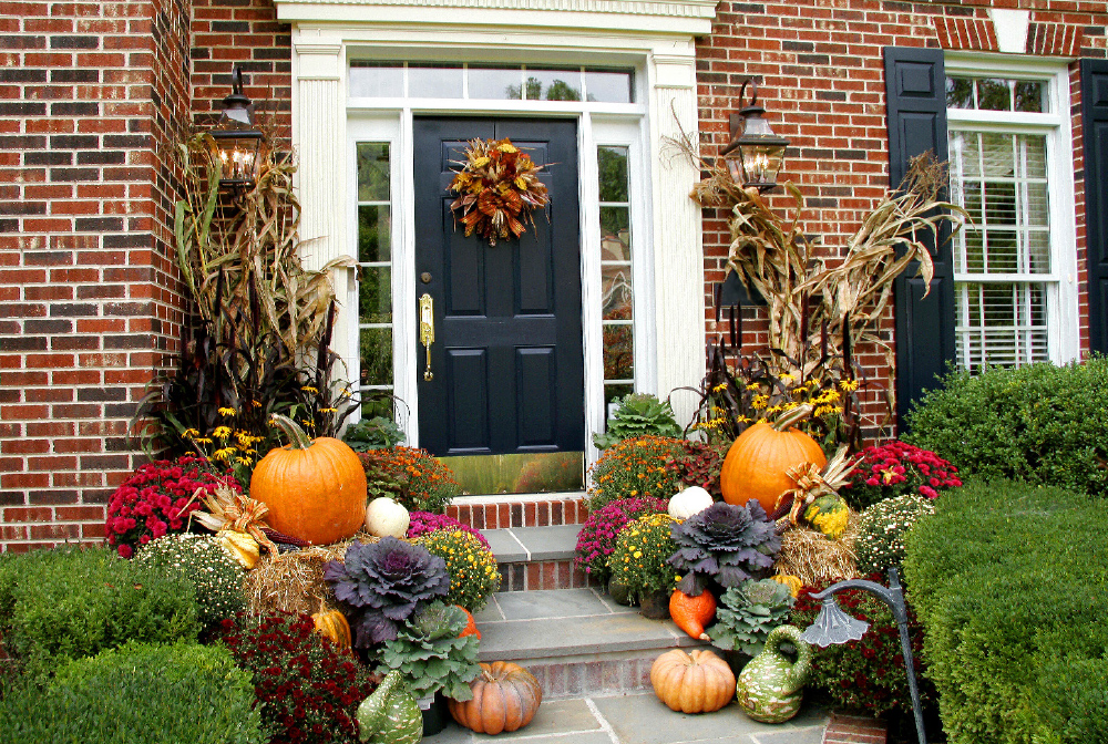 Pumpkins, gourds, dried foliage make for beautiful outdoor decor. Finish the look with a door wreath made of colourful fall leaves