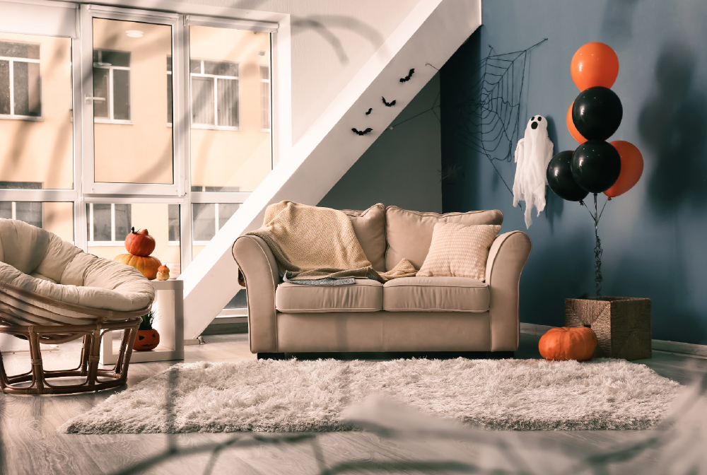 If you want to decorate a small place, try pops of orange with a pumpkin and balloons. Simple and cute!