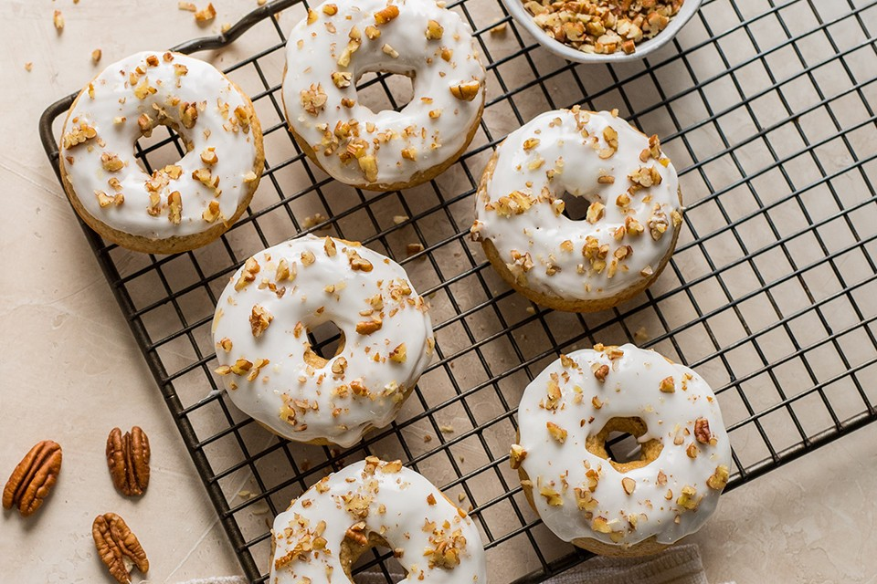 Pumpkin and Hazelnut Donuts recipe for Fall. This simple recipe is baked and glazed with an easy hazelnut cream glaze.