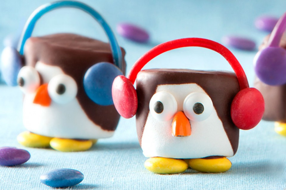 SMARTIES Penguins recipe. These cute marshmallow penguins are covered in melted chocolate and decorated with SMARTIES pieces.